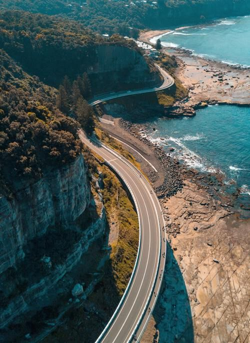 Road running alongside the ocean in Australia