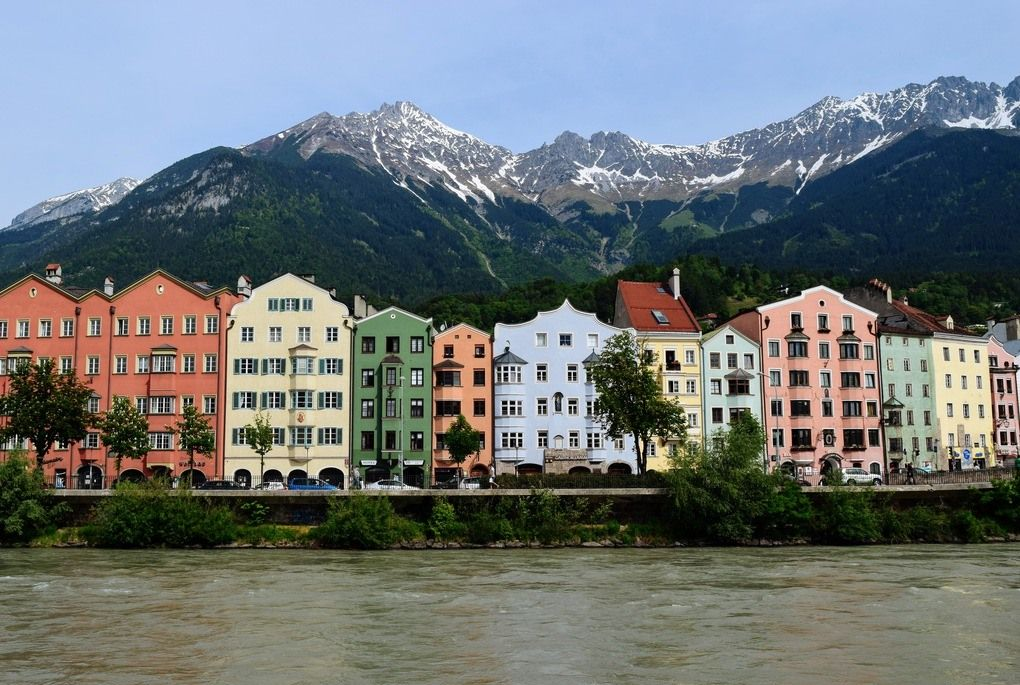 Colorful homes in Innsbruck, Austria with mountains in background