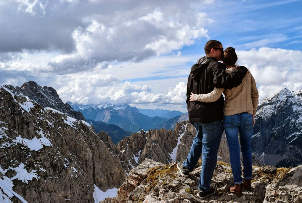 Couple standing on mountains in Innsbruck