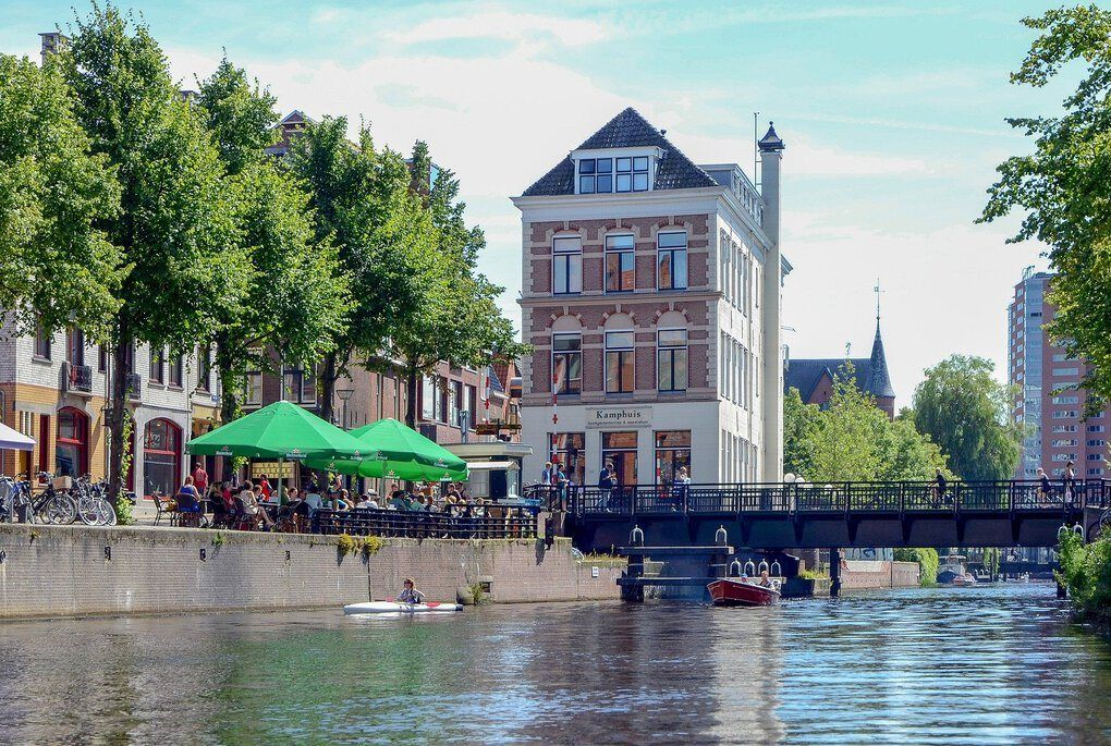 People eating by canal in Groningen