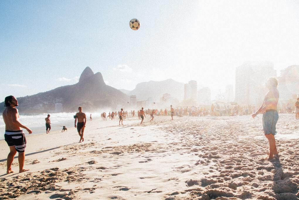People playing sports on Ipanema beach