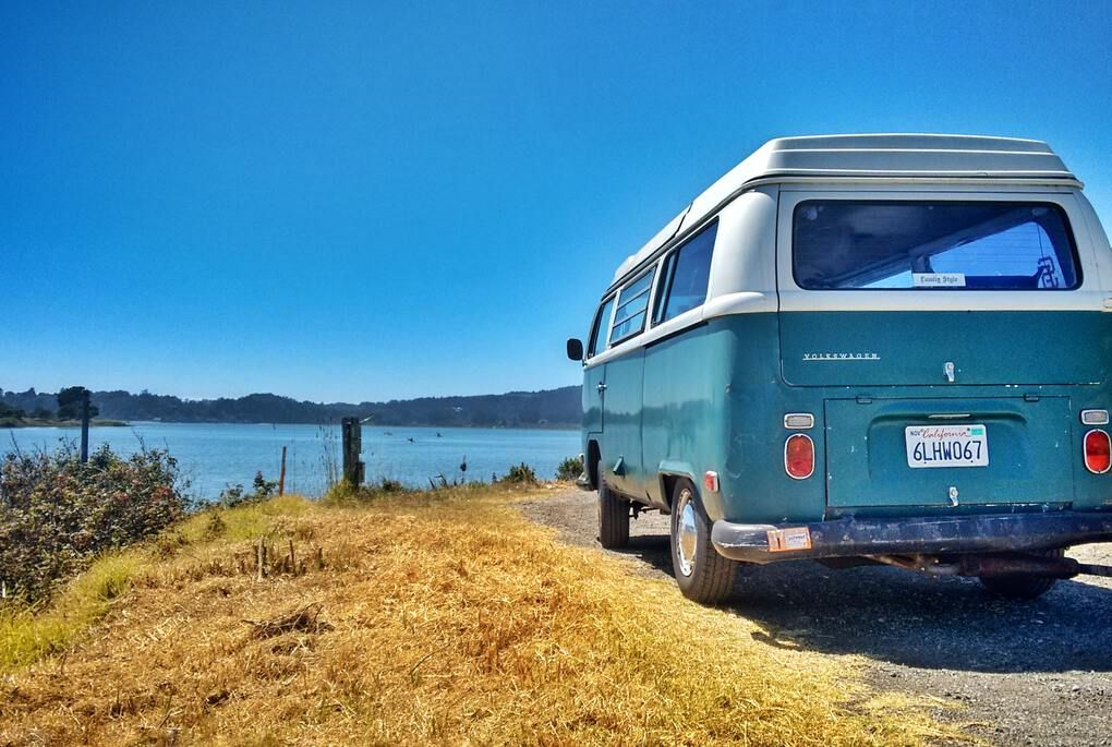 Blue RV caravan beside the lake