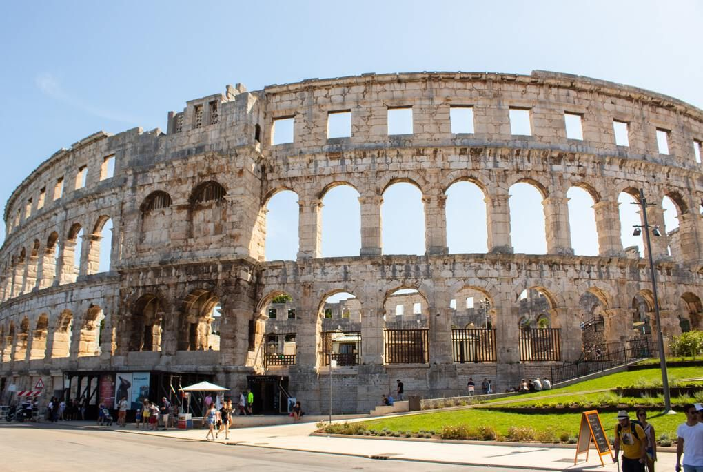 Pula Arena roman architecture arena resembles the Colosseum with people waiting outside
