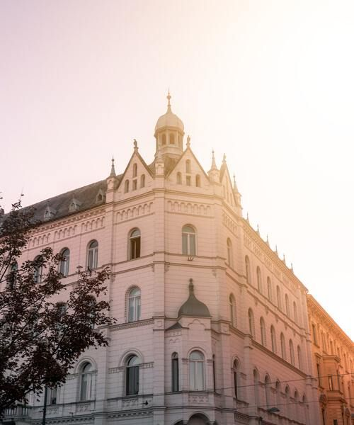 Zagreb Croatia, white building with beautiful architecture and pink sky
