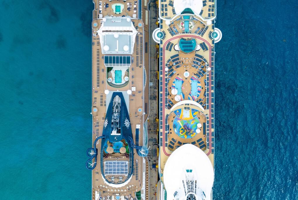 Top view from a drone looking down on two cruise ships in the blue ocean