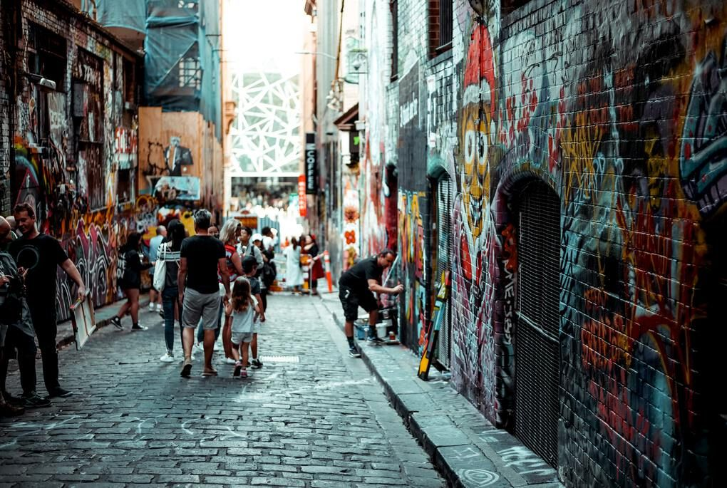 People tagging Street art in Melbourne