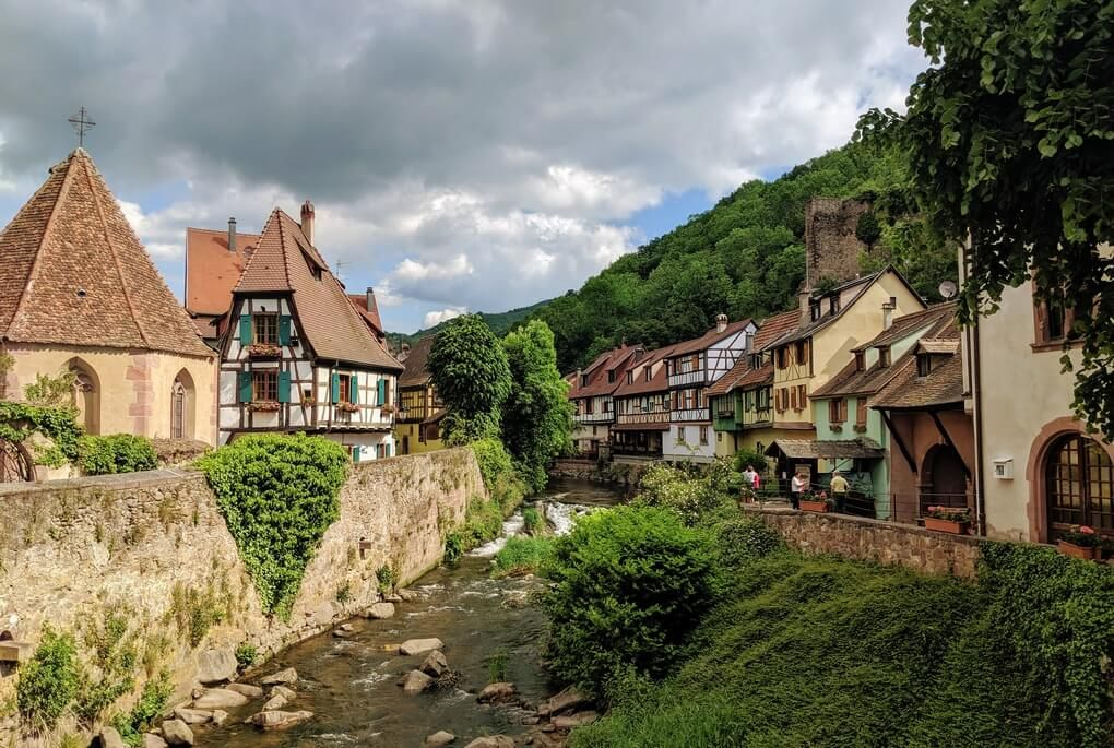 Canal lined with half-timbered homes in Kaysersberg, Alsace, France