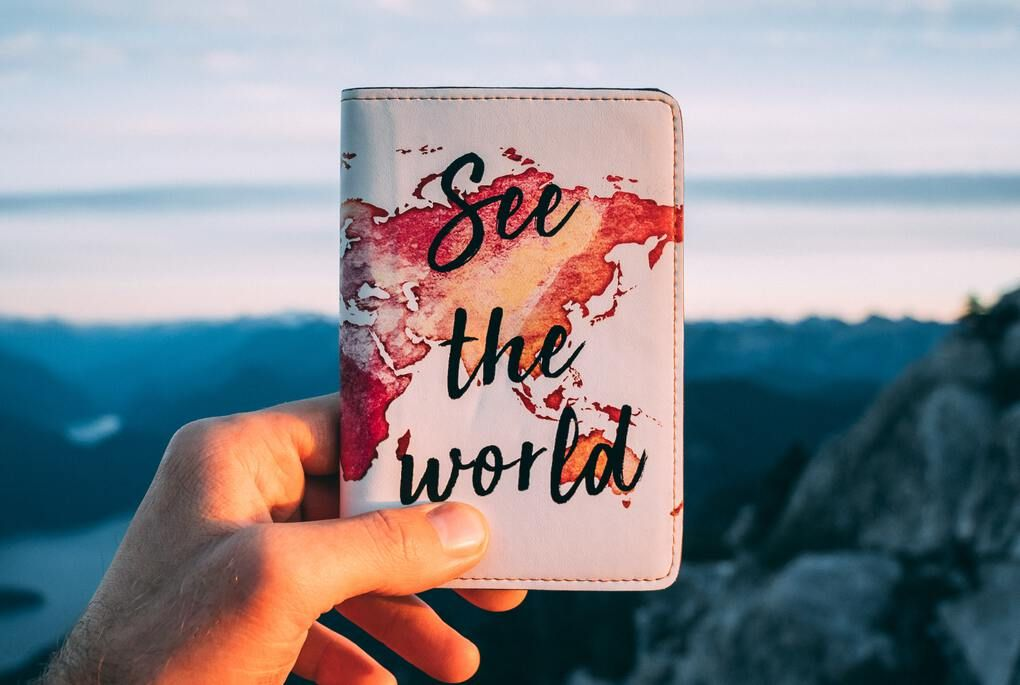 Passport case with watercolor world map and see the world printed in brush font
