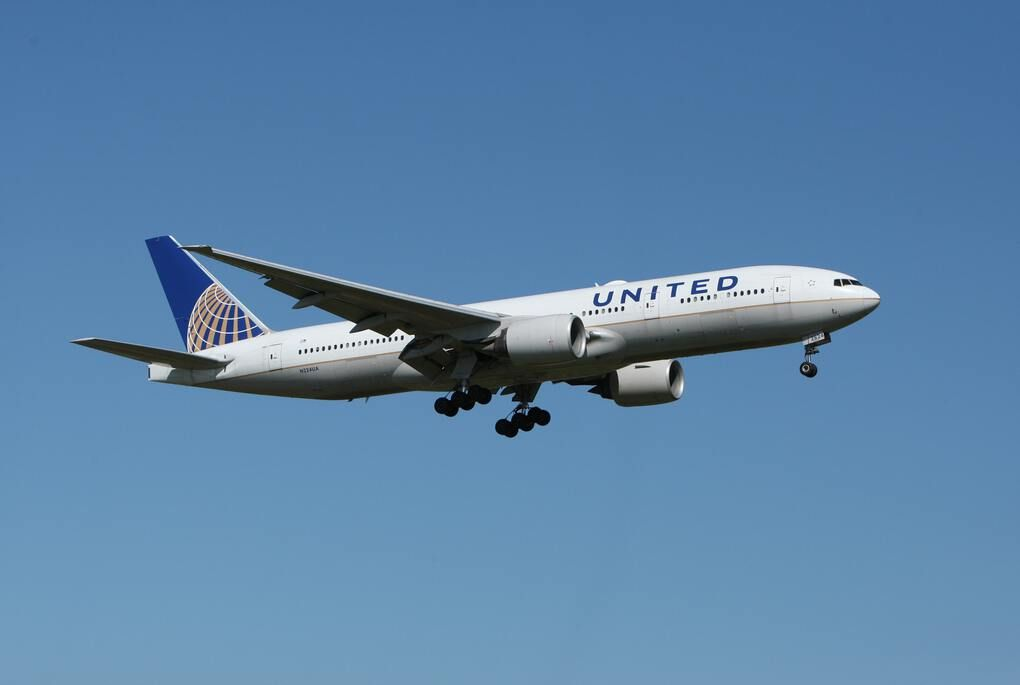 White United Airlines plane in the blue sky