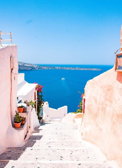 Pink buildings leading to the Mediterranean in Oia, Santorini, Greece