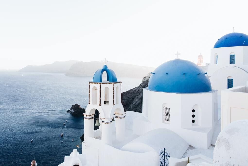 White buildings with blue roofs on Santorini Greece