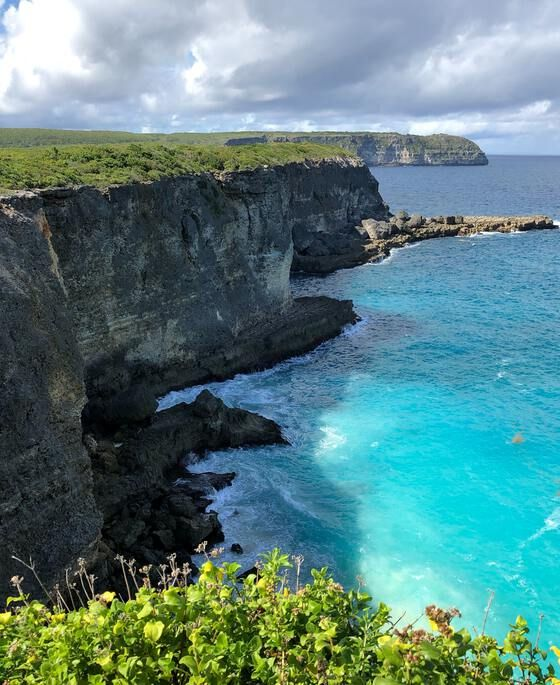 Seaside cliffs towering above blue waters