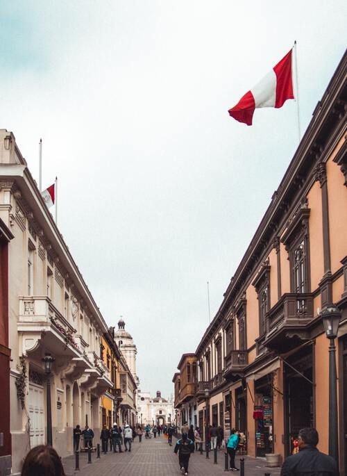 Street in Lima with Peru flag waving