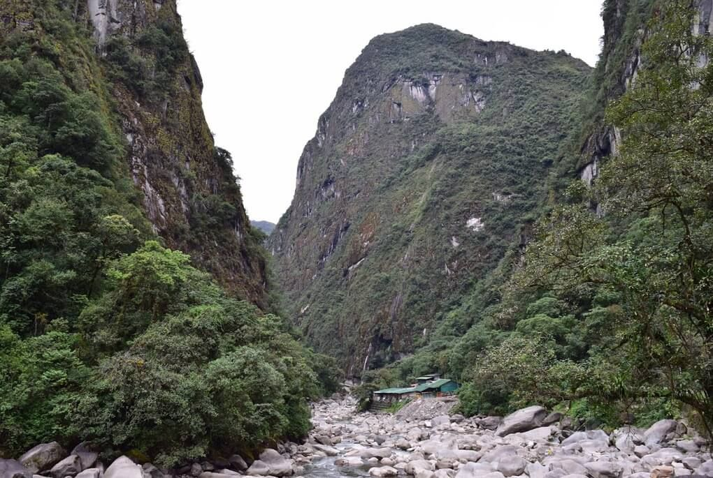 Hiking up a river through lush green mountains