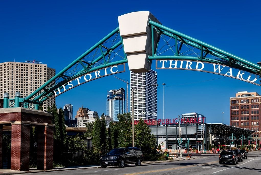 Entrance to the Historic Third Ward in Milwaukee with neighborhood sign and the Milwaukee Public Market sign