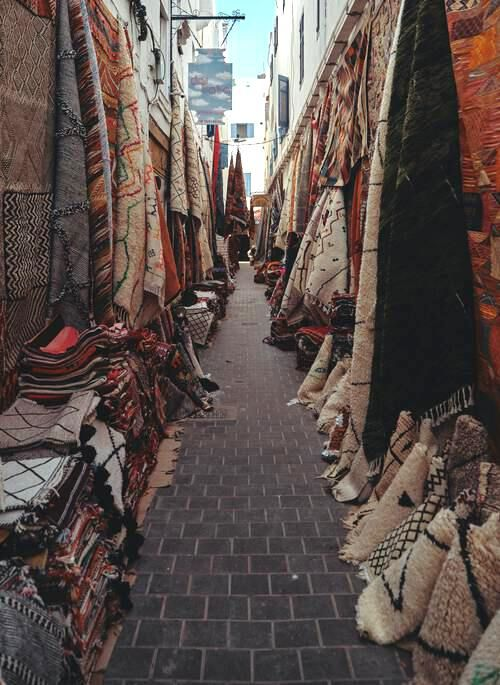Lots of rugs in a Moroccan souk in Essaouria