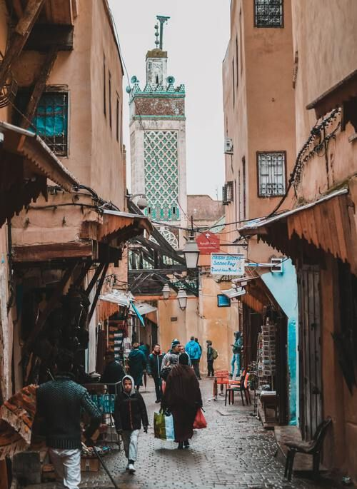 Market alley in Fez with people walking
