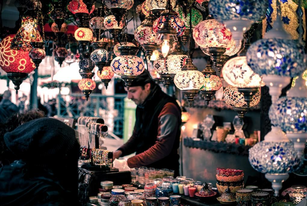 Man surrounded by colorful glass lanterns