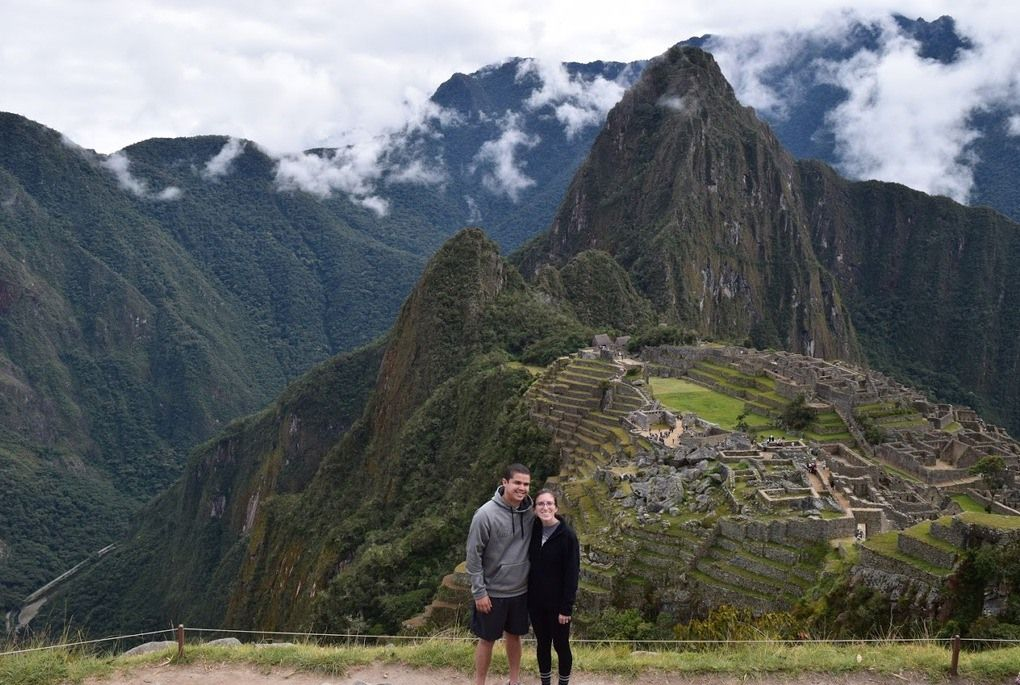 Couple standing in front of Macchu Picchu, Peru