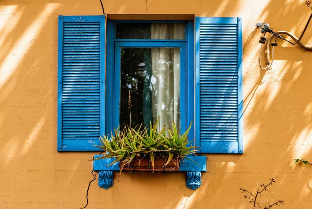Yellow wall with blue door in Surry hills