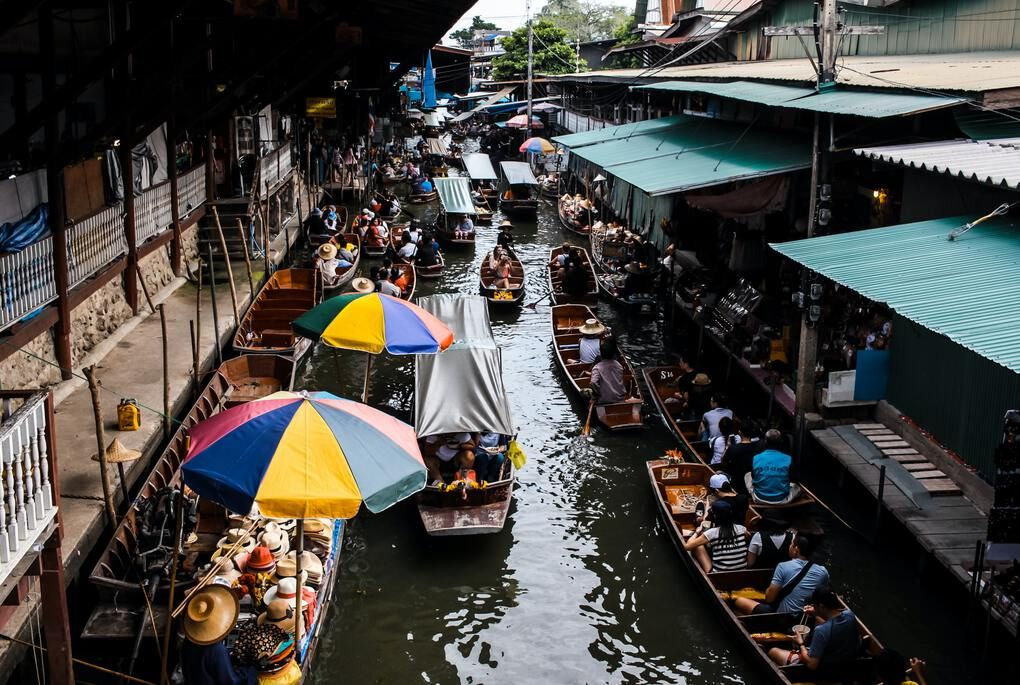 Floating market with boats and umbrellas