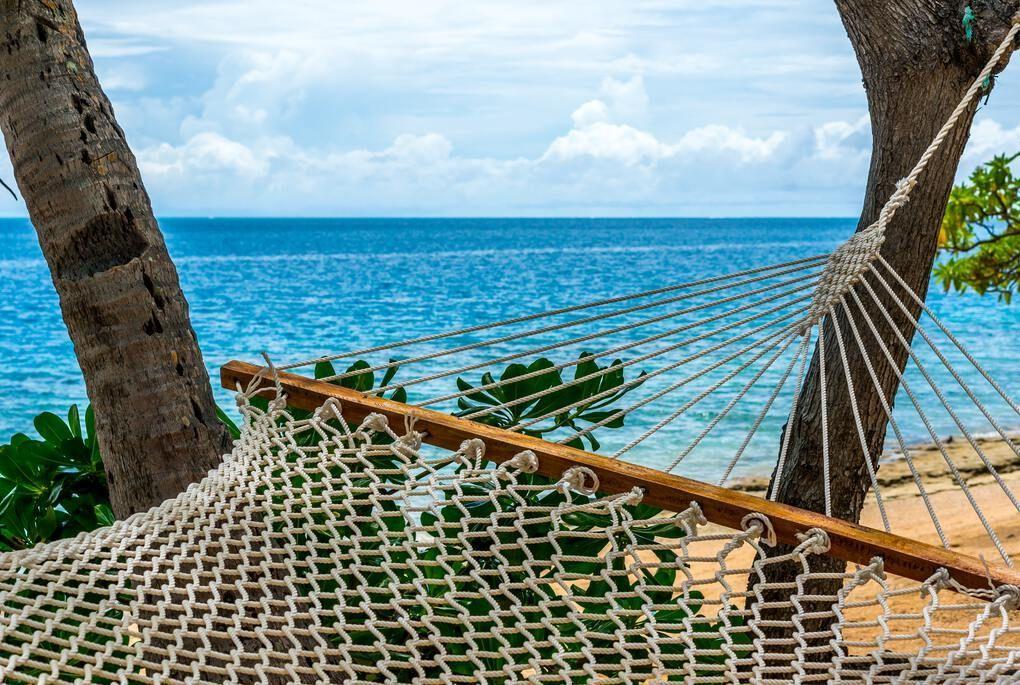 Hammock on the beach overlooking the ocean in Fiji