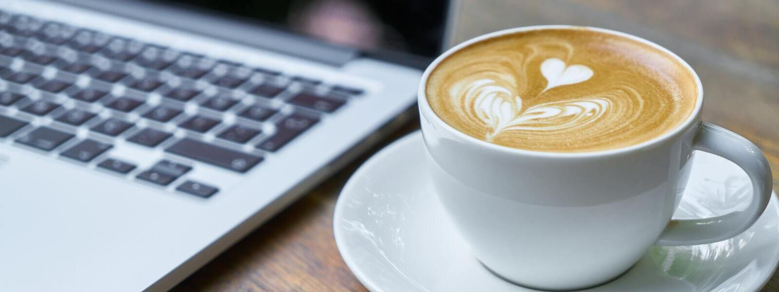 Writing a blog post with coffee and computer